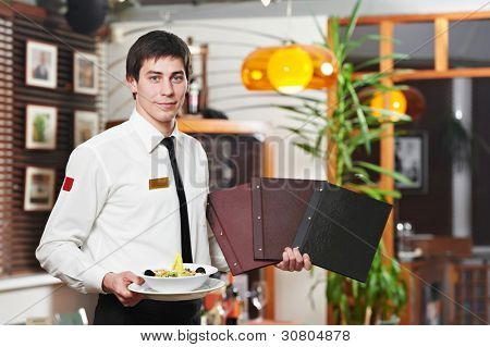 handsome man waiter in uniform with dish plate and menu and wine card at restaurant