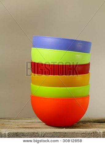 colorful plastic tableware on a gray background