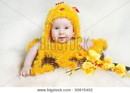 Baby In Easter Basket With Eggs In Chicken Costume