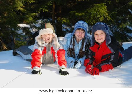 Happy Children In Snow