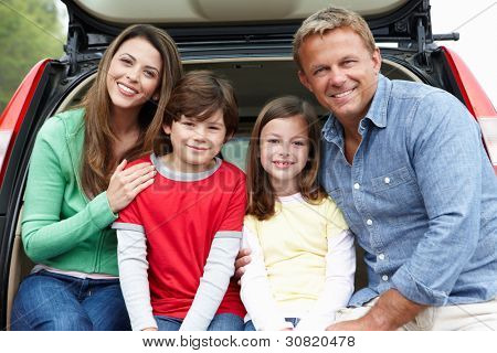 Family outdoors with car