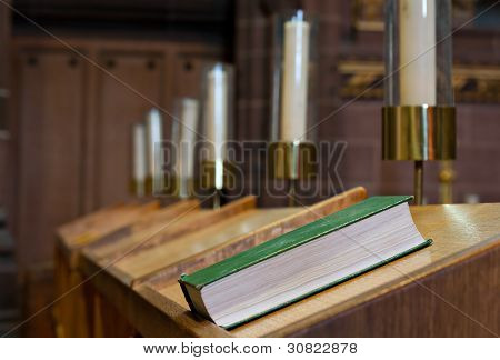 Bible On Wooden Bench In Church
