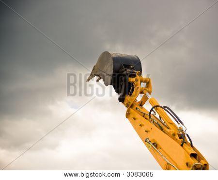 Heavy Orange Excavator Arm Reaches The Sky