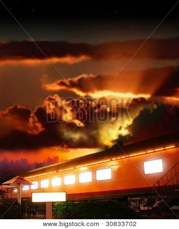 Dramatic fantasy concept photo of a glowing old railway boxcar against dramatic sunset