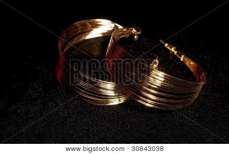 Gold jewelry gold rings on a black background