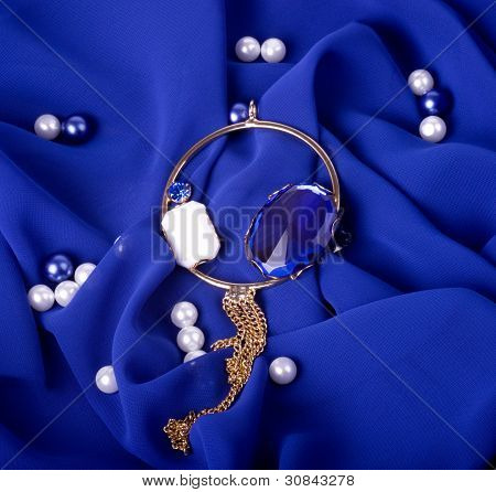 Gold jewelry on a dark blue background