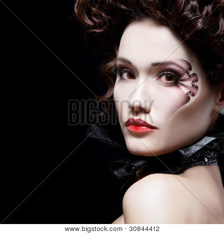 portrait of beautiful halloween woman vampire baroque aristocrat over black background