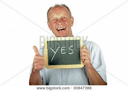 Positive man showing thumbs up with sign '' yes''