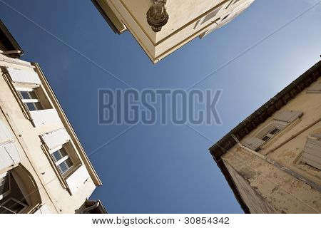 three buildings and the sky
