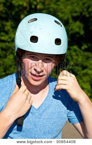 Portrait Of Cute Boy With Helmet In The Nature