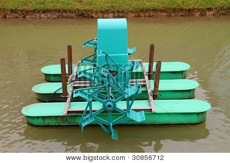 Water Wheel Floating On The Canal