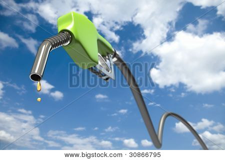 Fuel dripping out of a green fuel nozzle