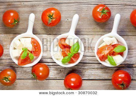 Italian salad on rustic wood