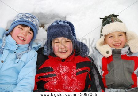 Children Laying In Snow