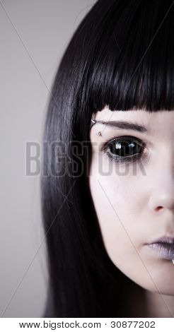 Spooky black eyed woman with pale skin, real sclera contact lenses