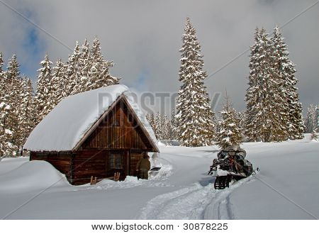 A Small Cottage In Winter