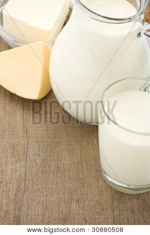 cheese and milk products isolated on wood background