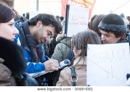 MOSCOW - MARCH 10: Signature-gathering campaign on the participants of the protest manifestation against falsification of the president election, Noviy Arbat in Moscow. March, 10, 2012 in Moscow