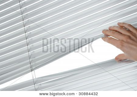 Female Hand Opening Venetian Blinds