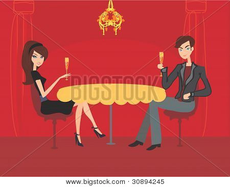 Young couple flirt and drink champagne