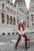 Young Female Tourist Sightseeing Building Of Hungarian Parliament In Budapest, Hungary. Trendy Woman poster