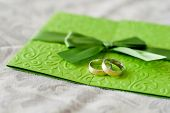 pic of wedding feast  - Wedding rings are on the green invitation to the feast - JPG