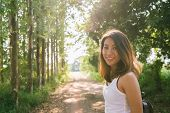 Happy Young Asian Woman Traveler With Backpack Walking In Forest. Hiker Asian Woman With Backpack Wa poster