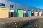 stock photo of roller door  - business units for small companies with colorful roller doors - JPG