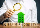 Businessman Puts Wooden Blocks With The Word Stamp Duty And House. Taxes Assessed During The Transfe poster