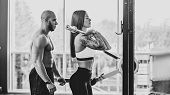 Young Fit Woman Doing Fitness Training With Instructor In Black And White Conversion poster
