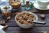 Healthy Lifestyle Breakfast Bowl Plate With Granola And Spoon On Brown Wooden Table Background, Cere poster