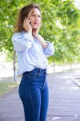 Worried Concerned Beautiful Girl Excited With Phone Call In Park. Stressed Young Woman In Casual Spe poster