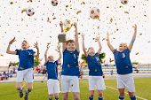 Happy Boys Celebrating Soccer Championship. Youth Football Winning Team Jumping And Rising Golden Cu poster