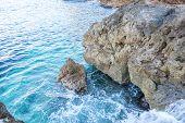 Ibiza, Mediterranean sea crashing against the rocks of the Spanish island of Mallorca, Ibiza, Spain. poster