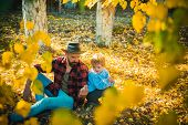 Hipster Bearded Dad With Cute Son Spend Time Together In Forest. Family Time. Brutal Bearded Man And poster