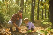 Brutal Bearded Man And Little Boy Enjoy Autumn Nature. Family Values. Explore Nature. Wanderlust Con poster