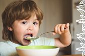 Hungry Little Boy Eating. Cheerful Baby Child Eats Food Itself With Spoon. Tasty Kids Breakfast. Bab poster