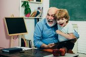 Grandfather And Grandchild - Generation People Concept. A Grandfather And A Toddler Are Learning In  poster