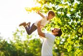 Concept Of Fathers Day! Happy Family Dad And Child Daughter    In Nature. poster