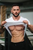 Young Athlete Posing With A Torso For Photography In Gym. Bodybuilder, Athlete With Pumped Muscles,  poster