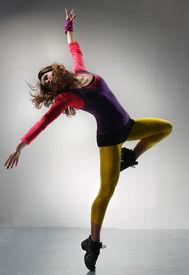 image of ballet dancer  - beautiful modern ballet dancer posing on a gray background - JPG