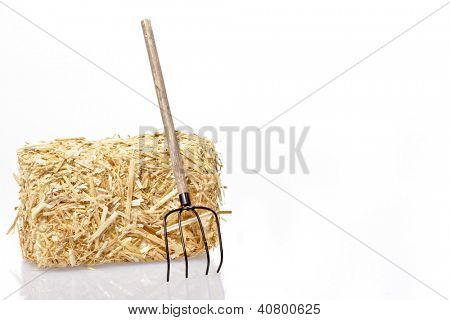 Hay bale with tool on a white background