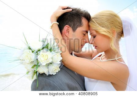Just married couple sharing romantic moment