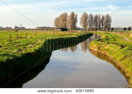 Canal By Dutch Farm House