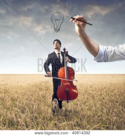 Hand drawing over a cellist on a large field a bulb