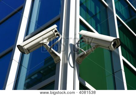 Two Security Cameras On Glass