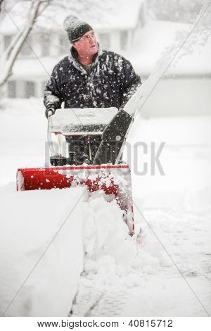 Man using a snowblower