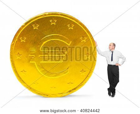 Businessman with big golden coin. Investment and saving concept.