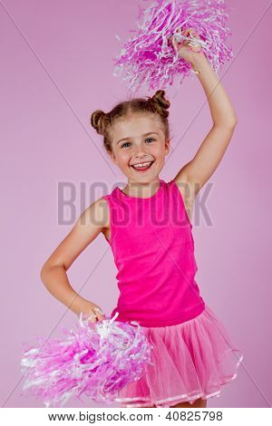 Cheerleader girl with pompoms, lovely little cheerleader kid