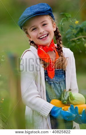 Gardening, gardener, kid - lovely girl with picked vegetables